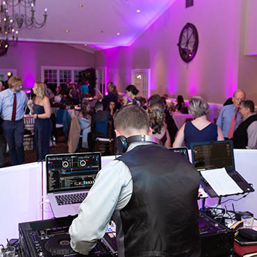 Wedding DJ Mixing Music at Harvest Restaurant